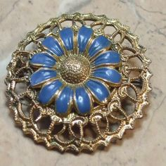 Circular filigree flower vintage brooch circa 1930s with blue and gold colors Bohemian jewellery in a filigree and a great vintage looking flower to wear