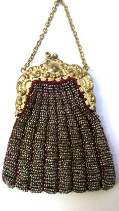Delicate Small Antique Purse with Elaborate  German Silver Frame and Metal Beads.  via Etsy.