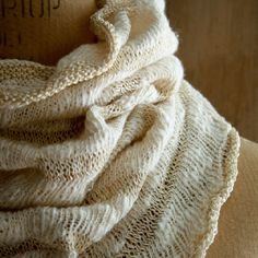 This cowl is knitted using Habu's thick-and-thin Cotton Nerimake Slub.  Set against the cotton are thin stripes of Alchemy's Silken Straw, a meticulous, flat silk ribbon with a crisp finish and pearly shine. (from the Purl Bee)