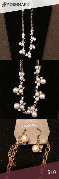 """Paparazzi """"Love Story"""" Faux Pearl Necklace Dainty clusters of shimmery white pearls are dusted with sparkling Rhinestones, creating a romantic, timeless design. Adjustable clasp closure with matching earrings paparazzi Jewelry Necklaces"""