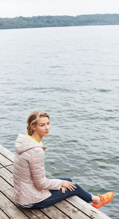 Enjoy a cool morning walk by the water this summer with stylishly comfortable jeans and a sporty, pale pink light down jacket form Bogner Woman.