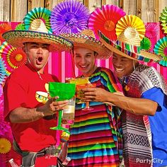 Say cheers to Cinco de Mayo with sombreros, booze belts and giant margarita glasses for a perfecto photo op!