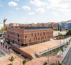 Much of the sports centre is submerged underground, creating a public plaza at the entrance, Luz Natural, Barcelona Sports, Types Of Bricks, Timber Roof, Basement Floor Plans, Thermal Mass, Image Sites, Urban Fabric, Brick Facade