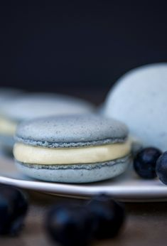 These stunning blue macarons are made with real blueberries and filled with a cream cheese filling and blueberry compote. Heaven in every bite! French Macaroon Recipes, French Macaroons, Blue Macaroons, Fun Desserts, Delicious Desserts, Dessert Recipes, Macaron Recipe, French Macarons Recipe Flavors, Macarons Filling Recipe