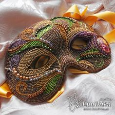 Gorgeous bead embroidered mask.