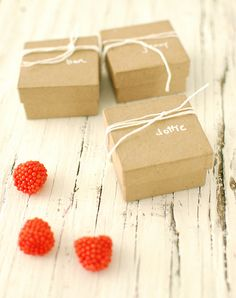 Sweet and simple, kraft paper boxes filled with raspberry candies