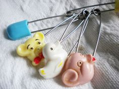 Vintage diaper pins • http://redgatefarmcuster.blogspot.com/2011/04/baby-shower-with-vintage-twist.html