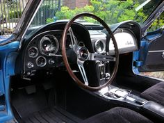 Driver side interior. Redline on tach is 5500 to 6000.