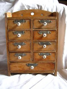 ButtonArtMuseum.com - Vintage wooden spice rack with german metal signs, porcelain buttons 9 drawers