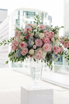 Soft pink ceremony florals accented with dusty blue hydrangeas designed by Rachel A. Clingen.