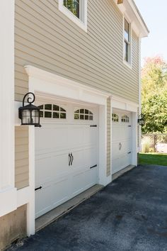 Residential white carriage garage doors with top windows single these garage doors are beautiful james hardie design ideas publicscrutiny Image collections