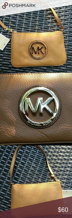 Authentic Michael Kors wristlet NWT. Soft leather. All new and shiny. Michael kors Bags Clutches & Wristlets
