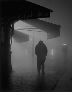 Sabine Weiss ::   Man in the Fog, Boulevard Murat, Paris, 1951 / more [+] by this photographer