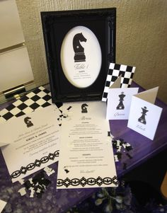 Selection of wedding stationery chess artwork on display