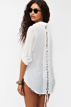 laced tail blouse- gives your typical white blouse a little edge.