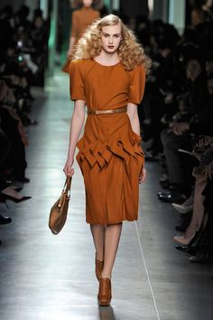 Midcentury Vibes Both Bottega Veneta and Prada's collections feature organic shapes, sculptural details, and the warm, earthy color palette of midcentury modern design that left us crave natural finishes and clean lines.