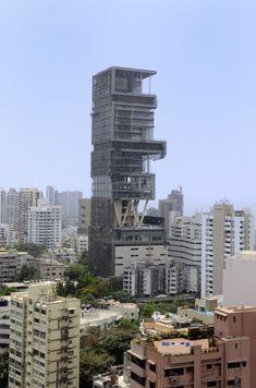 built next to the Golibar slum in Mumbai, this building houses one family. ONE family.