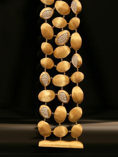 Marco Bicego 18KT Yellow Gold Confetti Isola Three Row Bracelet with Pave Set Diamonds. Available at London Jewelers.
