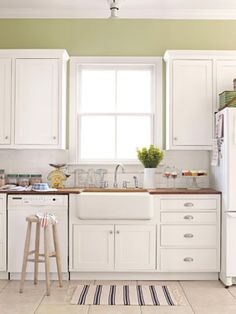 A Budget-Friendly Kitchen    Great design doesn't have to cost a bundle. The cabinets are fitted with affordable pulls. The farmhouse sink cost $75 at a flea market.      Read more: Kitchen Designs - Pictures of Kitchen Designs and Decorating Ideas - Country Living