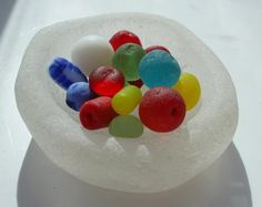 Actually, looks like beads and a small marble? What a great little collection, wow!  ~ David and Lin