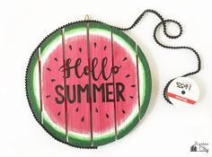 Create a Watermelon Hello Summer Sign to welcome in summer! A great alternative to a traditional wreath and a fun way to celebrate summertime.
