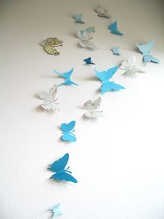 butterfly map decorations. Maybe have the lady on Etsy make specific butterflies & Matte & frsme