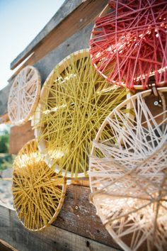 Yarn wrapped embroidery hoops create a gorgeous rustic photo backdrop!