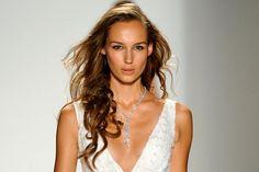 A model walks the runway wearing Leviev diamonds.
