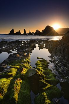 Sunrise on Gueirua beach in Asturias, Spain