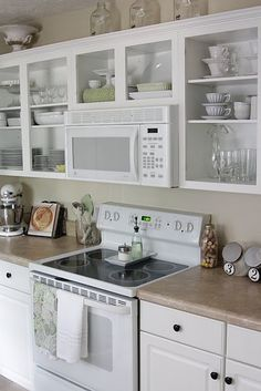 Favorite tip: 15 Ways to Update Your Kitchen on a Dime. Some good tips in this article, including putting out a basket of all your most used cooking essentials, accenting with a pretty wood cutting board. Great way to corral the clutter in style.