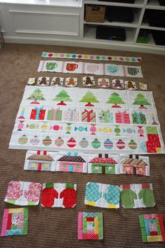 It's done! It's done!   Six days ago this quilt was just 5 tree blocks, 7 present blocks and a stocking. And as of last night, it is a fini...