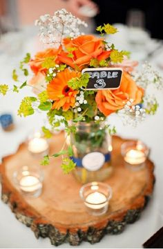 Country orange and white wedding centerpiece