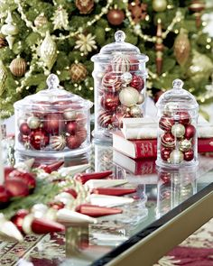 For sophisticated sparkle, fill glass containers with glittering ornaments of different shapes.