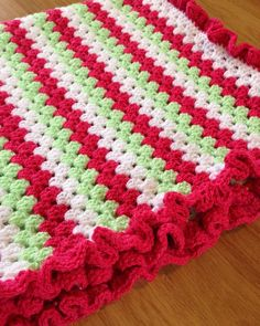 Granny stripe blanket with ruffle edging is now complete  by peggyscozycomforts