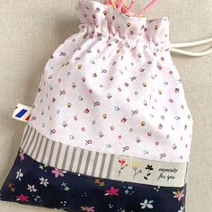 Create this adorable and easy-to-sew string bag designed. Minki also shares a link to her free fabric mask pattern in the tutorial. Visit weallsew.com for details.