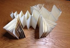 """Fishbone Fold Structures – In Cooperation with Northwoods Book Arts Guild       Instructor: Connie Stricks        Join this workshop to create the """"Fishbone Fold Book,"""" a sculptural structure attributed to master book artist Hedi Kyle. Constructed from a single sheet of paper that is score"""