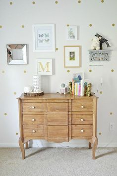 Gallery wall with gold polka dot wall