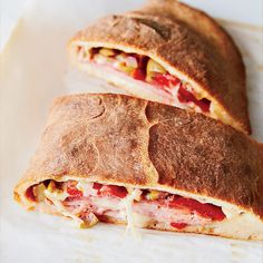 This riff on the classic muffuletta becomes a hearty, delicious and satisfying calzone in under 45 minutes.