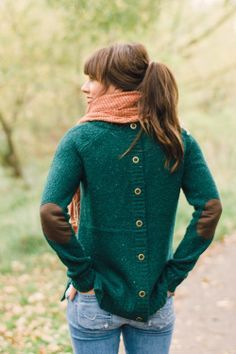 back-buttoned green sweater with brown elbow pads