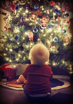 I love the red white and blue on this tree! Also cute photo for Emma's first Christmas.