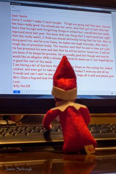 Elf on the Shelf writing a letter back to Santa.