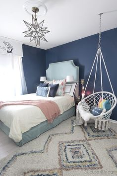 dark blue teenage girl room with turquoise velvet bed and macrame hanging chair