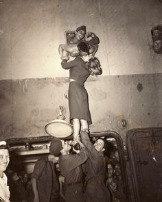 Actress Marlene Dietrich kisses a soldier returning home aboard the USS Monticello, 1945