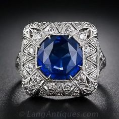 This striking, stunning and sizable early Art Deco sapphire and diamond ring highlights a bright and beautiful 4.50 carat royal blue Ceylon sapphire. The entrancing gemstone radiates from within a delicately milgrained octagonal setting enveloped in a sparkling cushion of diamonds, exotically adorned with a pierced stylized star motif. No attention to detail has been left unpaid, including a gracefully scrolled gallery, meticulous hand engraving and fine milgraining which continues all…