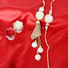 Send White Lumba Rakhi Set to your bhabhi