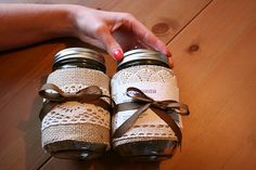 This page has a tutorial on wrapping mason jars with burlap and lace!