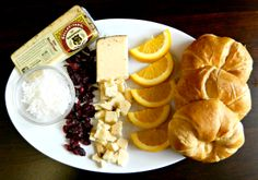 Chai BellaVitano with shredded coconut, dried cranberries, orange slices and croissants