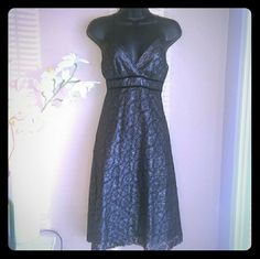 Dark Silver A-line Limited Dress Worn once, The Limited size 4. Spaghetti straps meet at a loop in the back and tie together. A-line flare in skirt. Fabric has a lace pattern and has glitzy flecks throughout. Metallic looking material The Limited Dresses