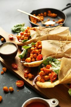 AMAZING Buffalo Chickpea Wraps with Creamy Tahini-Maple Dressed Salad! Satisfying, healthy, SPICY! #vegan #recipe #healthy #dinner #plantbased #minimalistbaker