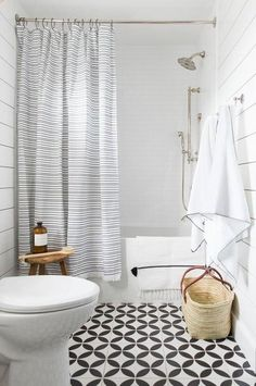Bathroom Decor shower curtain This Is How to Pack Big Personality Into a Small Bathroom Shiplap Bathroom, Bathroom Shower Curtains, White Bathroom, Small Bathroom, Bathroom Cabinets, Bathroom Bin, Silver Bathroom, Bathroom Storage, Master Bathroom